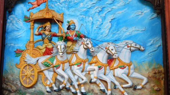 Wall art of Hindu God Krishna as charioteer and Arjuna as warrior in Mahabharata war